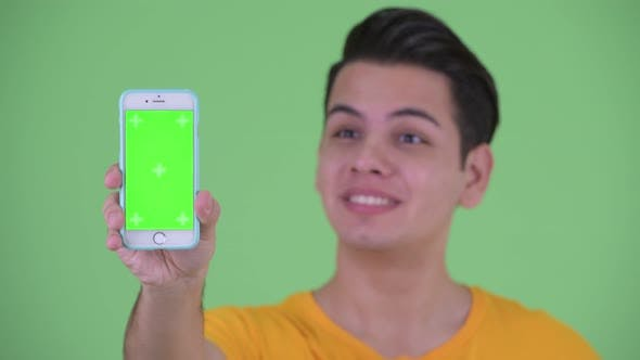 Thumbnail for Face of Happy Young Multi Ethnic Man Showing Phone