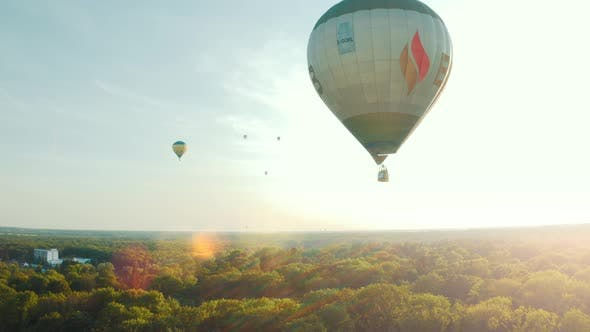 Thumbnail for Hot Air Balloon in the Blue Sky. Balloon Flies Against the Sunrise. Beautiful Romantic Summer Scene