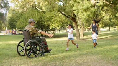 Happy Kids and Their Mom Running to Disabled Military Dad