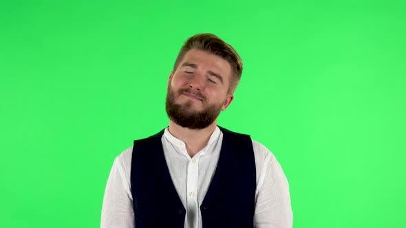 Thumbnail for Man Daydreaming and Smiling Looking Up Against Green Screen