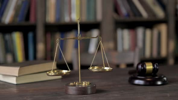 Thumbnail for Gold Brass Balance Scale with Books and Gavel on Judge Table