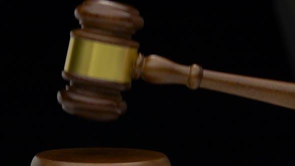 Thumbnail for Wooden Hammer Revolves Knocks on the Table. Black Background