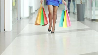 Girl in Highheels with Shopping Bags Walking with Confidence