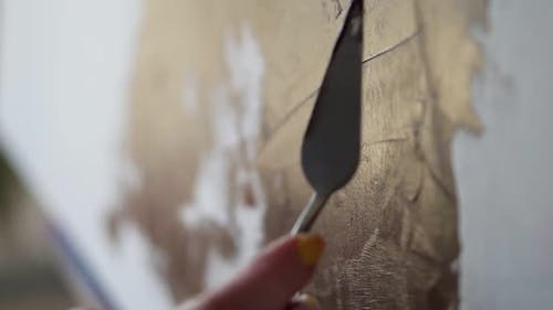 Unrecognizable Person Drawing with Spatula