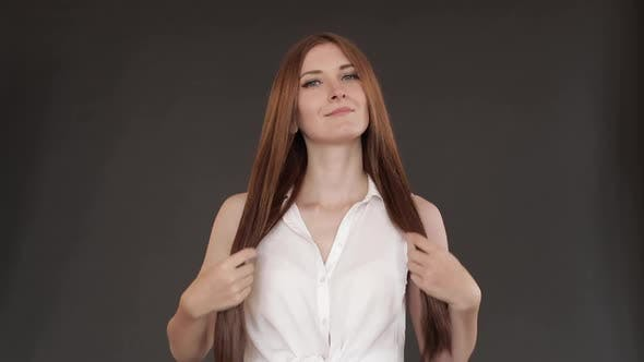 Thumbnail for Studio Shot of Brunette with Lips Playing with Hair