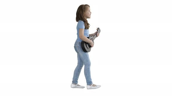 Thumbnail for Cute Little Girl Walking and Singing While Playing on Ukulele on White Background.
