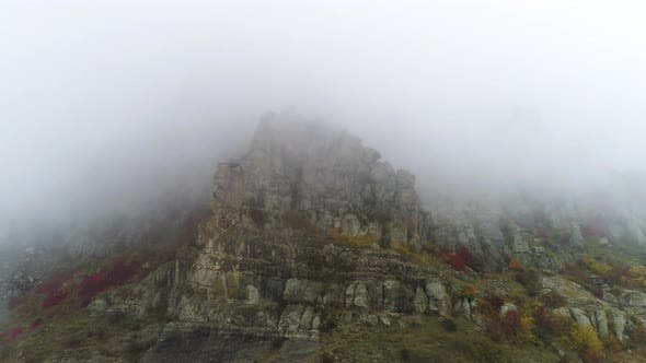 Thumbnail for Aerial View On Rocky Mountains In The Fog