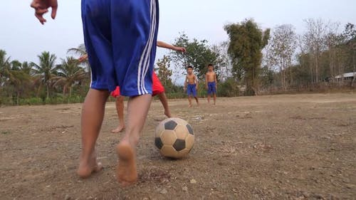 Children Playing Soccer  In Countryside