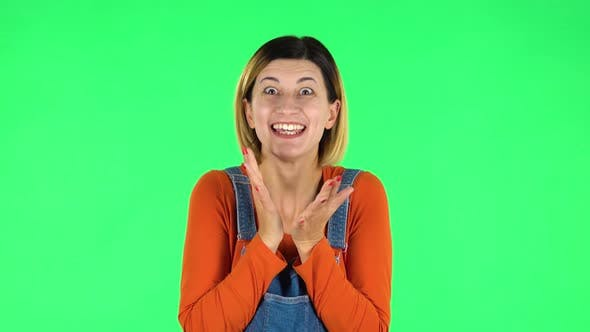 Cover Image for Girl Looks with Tenderness with Folded Arms in Front of Her. Green Screen
