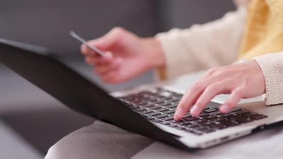 Thumbnail for Woman use of laptop computer for online shopping with credit card