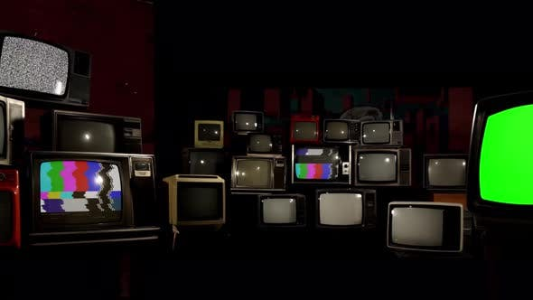 Thumbnail for Wall Of Retro TVs with Broken Screens and a Green Screen.
