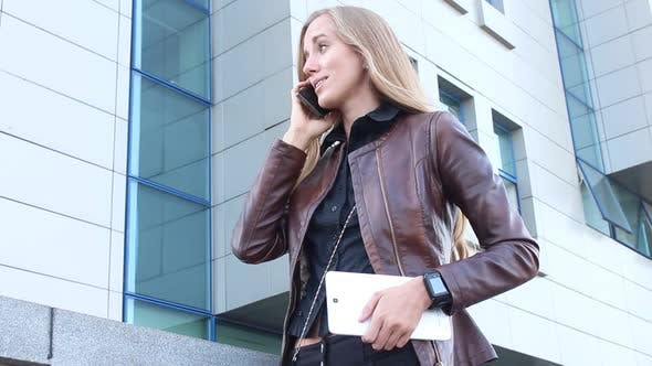 Thumbnail for Modern Woman Talking On The Phone In The City