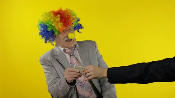 Clown Businessman Freelancer in Wig Holds One Buck Money Income and Loses It
