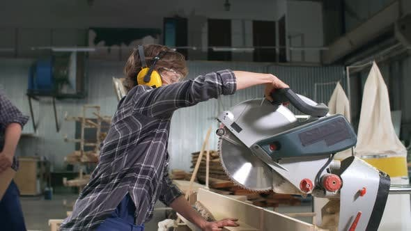 Thumbnail for Workers Using Circular Saw in Joinery