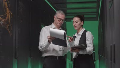 IT-Professionals Talking in Server Room