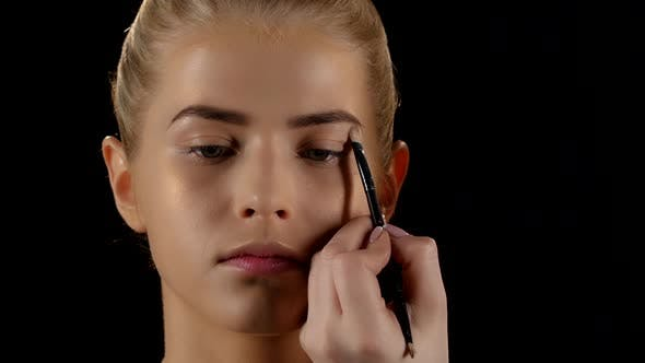 Thumbnail for Doing Make-up for a Woman Using Eyebrows Brush. Black. Closeup