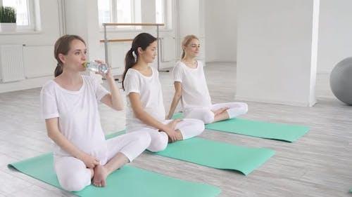 Pregnant Athletic Women Ready for Yoga Prenatal Exercise