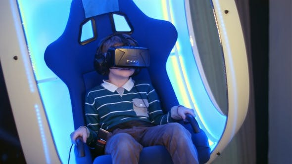 Thumbnail for Surprised little boy experiencing virtual reality in a