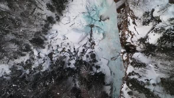 Flying over a frozen waterfall