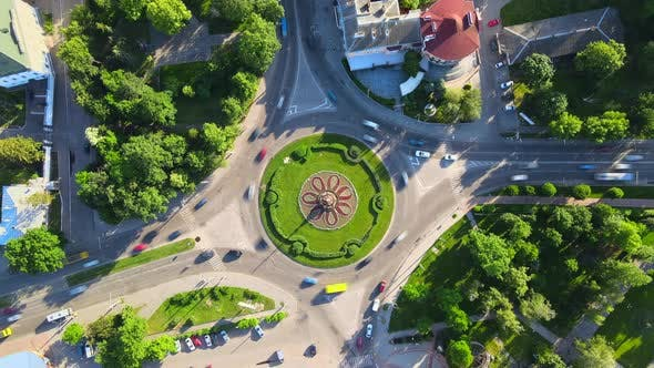 Thumbnail for Aerial View Timelapse of Roundabout Road with Circular Cars in Small European City at Sunny Day