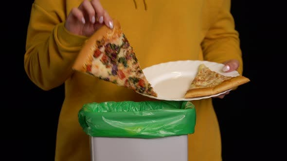 Thumbnail for Woman Scraping with a Plate a Pizza Into Garbage Bin