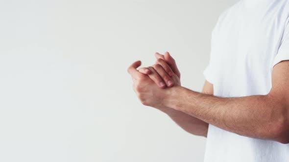 Hand Hygiene Skin Care Man Applying Cream or Oil