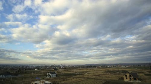 Time lapse footage with fast moving storm clouds on blue sky.