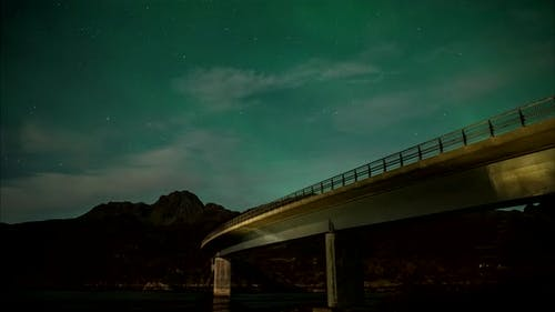 Northern lights above bridge in Norway
