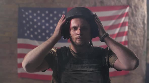 Thumbnail for Proud Injured Soldier in Helmet Against US Flag