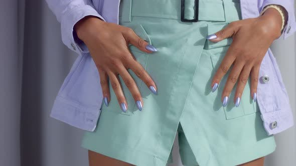 Thumbnail for Unrecognizable Woman in Pastel Color Clothes with Lilac Metallic Manicure Put Her Hands on Pockets