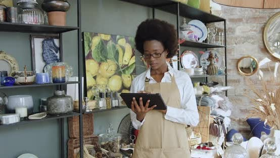 Thumbnail for African American Woman Working on Tablet pc in Beautiful Handmade Souvenirs Shop