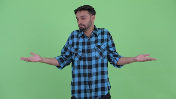 Thumbnail for Confused Young Bearded Persian Hipster Man Shrugging Shoulders