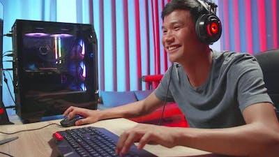 Gamer Man Playing Video Games On Computer