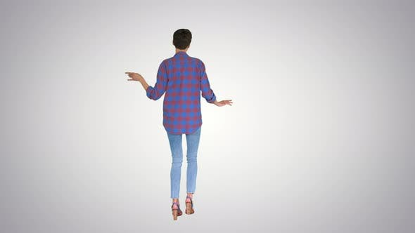 Cover Image for Woman in Casual Shirt Dancing on Gradient Background