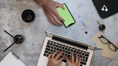 Business people working on laptop computer and smartphone with chroma key green screen