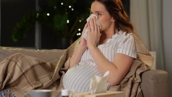 Thumbnail for Sick Pregnant Woman Blowing Nose at Home