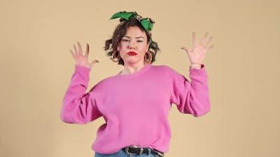 Stylish woman dancing funny dance. Music concept.