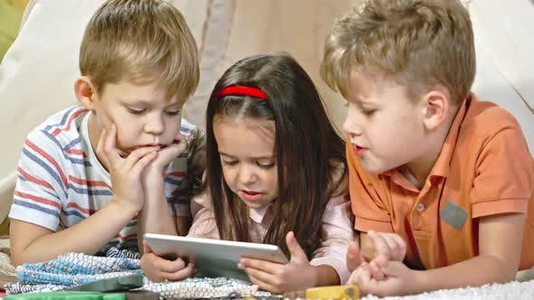 Cover Image for Little Children Watching Movie on Tablet
