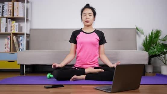 Woman meditating in lotus position sitting