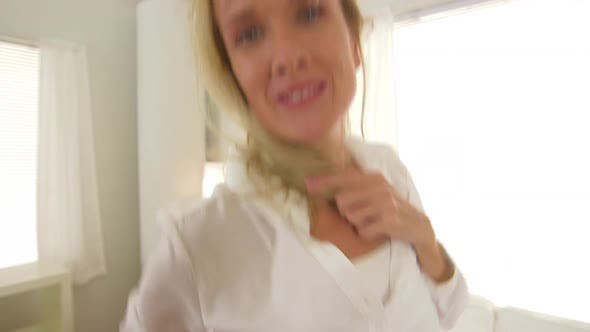 Thumbnail for Mature woman dancing in living room and smiling