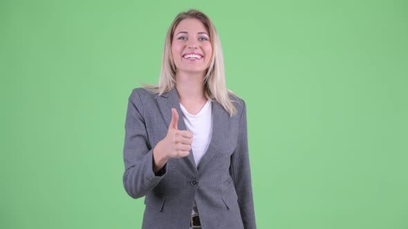Cover Image for Happy Young Beautiful Blonde Businesswoman Giving Thumbs Up