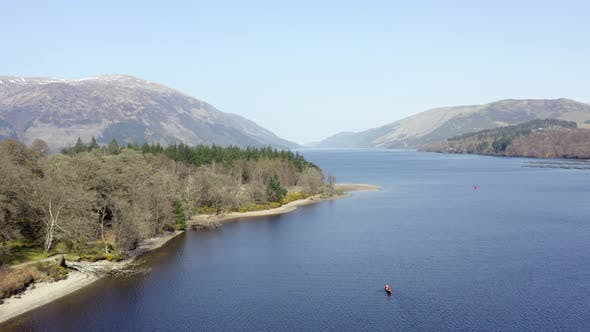 Canoeists in Scotland in a Loch Surrounded by Beautiful Landscape From the Air