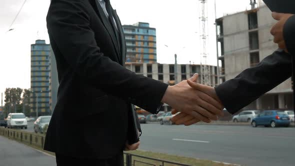 Customer and Architecture Shaking Hands