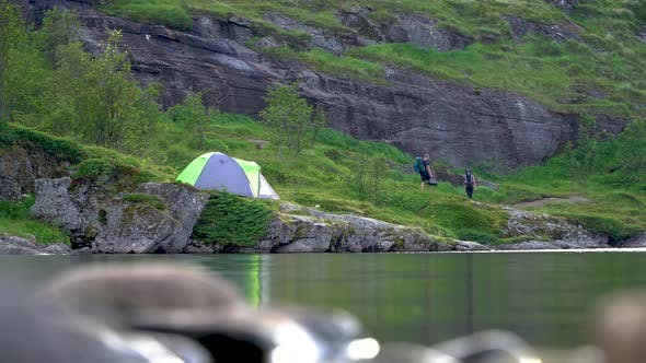 Thumbnail for Tourists and Tent Near the Lake
