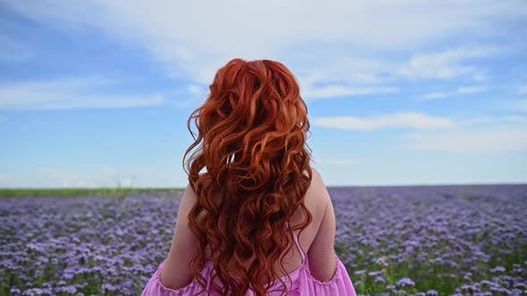 Flying Hair of a Redhead Woman