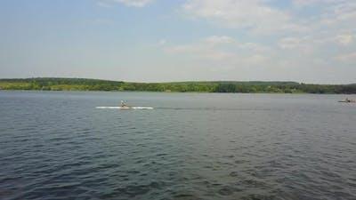 Children Training On Canoe. Group of children training kayaking in the river