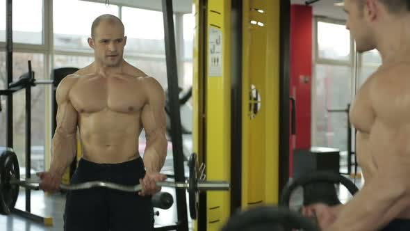 Thumbnail for Professional bodybuilder with perfect muscular body working out in the gym