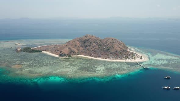 Drone Over Kanawa Island In Blue Sea