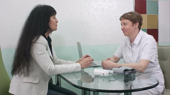 Thumbnail for Brunette Female Doctor Talking To Patient in the Hospital