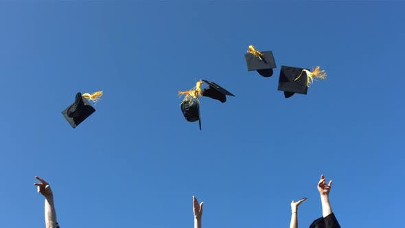 Thumbnail for Tossing graduation caps, slow motion